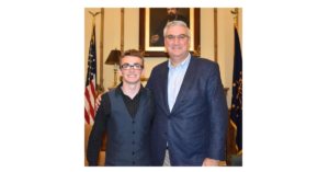 Foster Youth Joshua Christian poses with Governor Eric Holcomb.